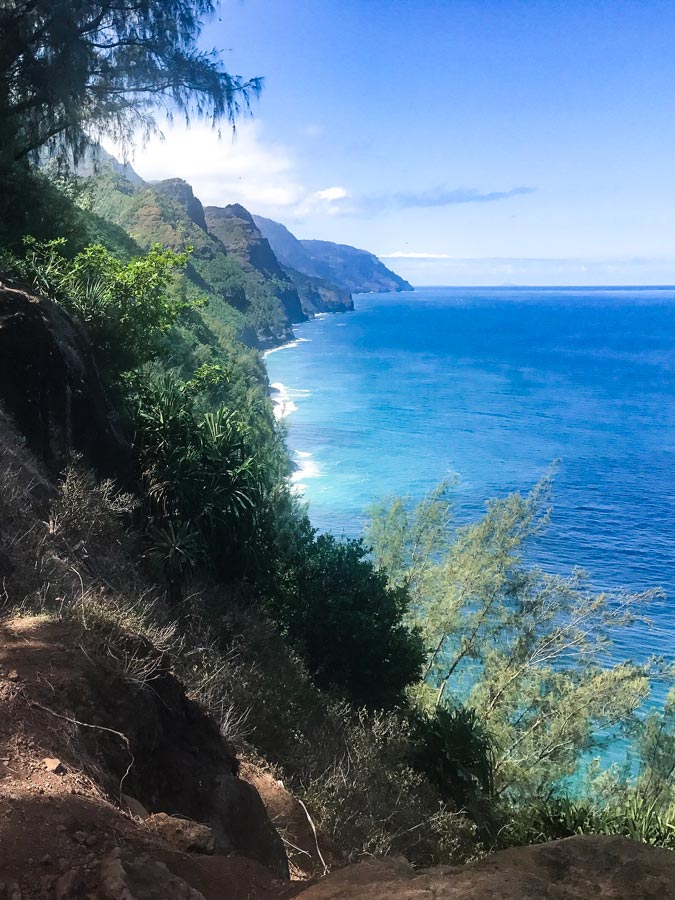 Napali Coast, Kauai is a must on your Itinerary with beautiful mountain and ocean views.