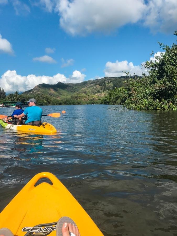 Kayaking to Secret Falls in Kauai. view of river with yellow kayak.