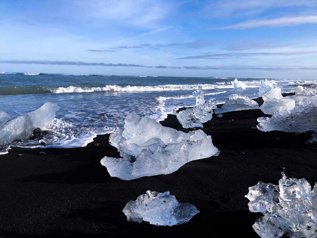Diamond beach with pieces of glacier ice on the beach