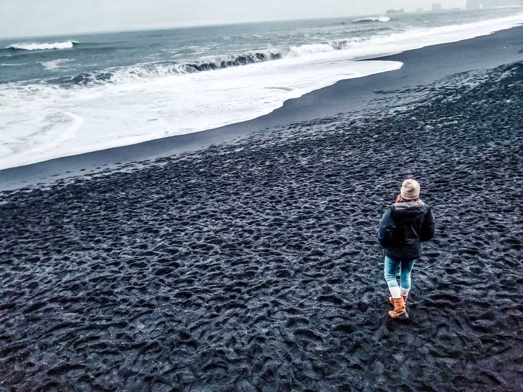 Walk down the black sand beach in Vik, Iceland