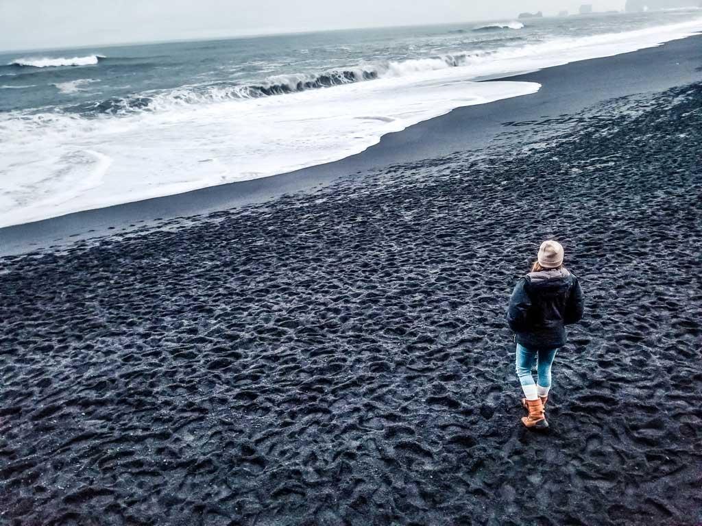 Walk down the black sand beach in Vik, Iceland