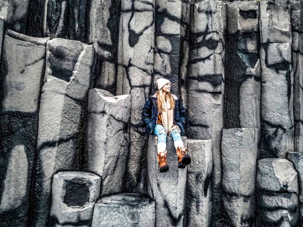 Take a seat on the Basalt columns on Vik, Iceland's black sand beach