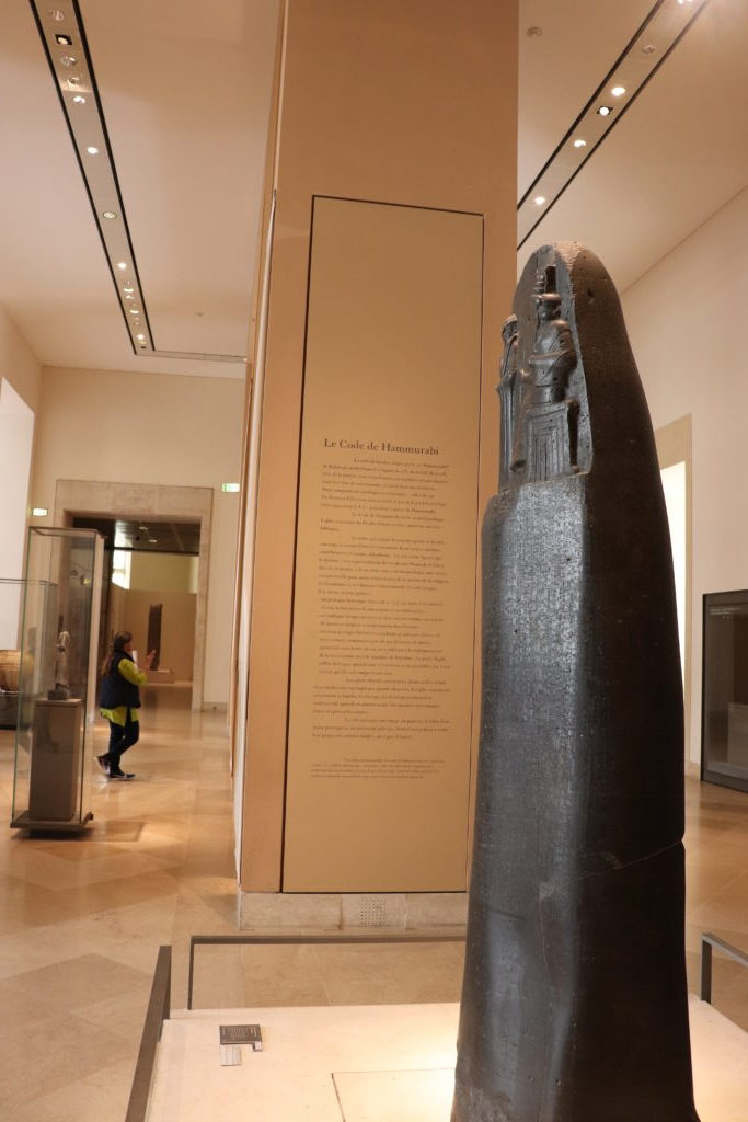 Your Ultimate guide for the top 10 Paris attractions including the Louvre museum to see the Code of Hammurabi