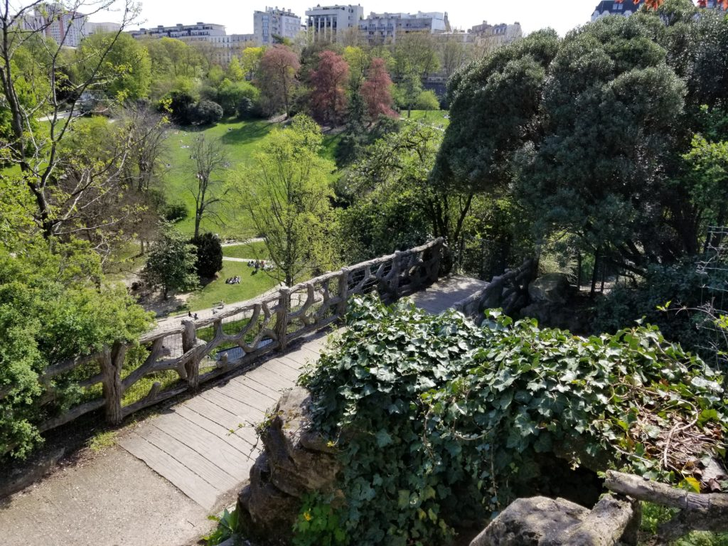 Visit Parc des Buttes Chaumont in Paris. A stunning park and garden considered to be a hidden gem and enjoyed by locals!
