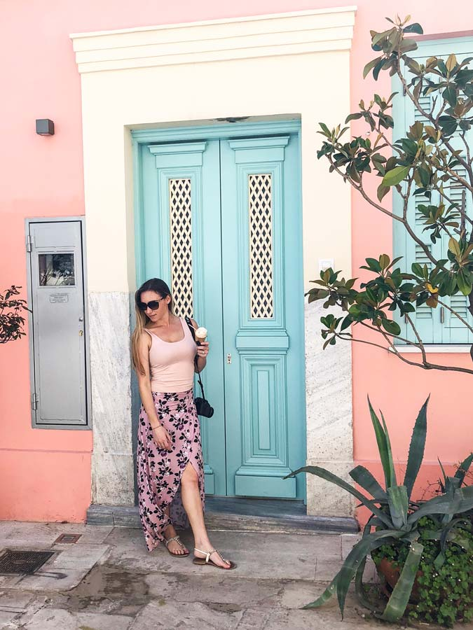 The Plaka Neighborhood is a must with 4 days in Athens. Colorful pink street with turquoise door.