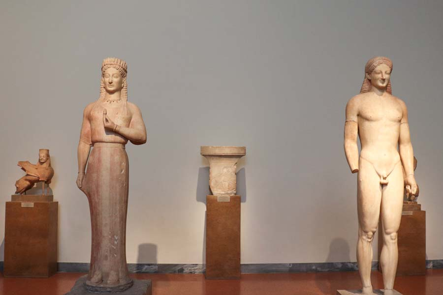 Kore and Kouros artifacts from the National Archaeological Museum in Athens, Greece.