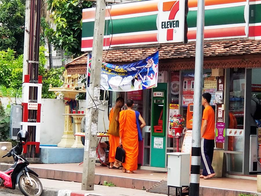 7/11 has everything you need while in Thailand. Outside of 7/11 with 2 monks