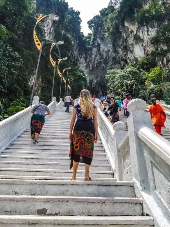 Malaysia travel inspiration with women walking up stairs