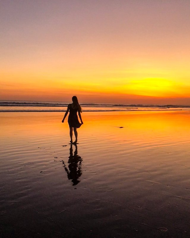 Dancing at sunset on double six beach in Seminyak, Bali