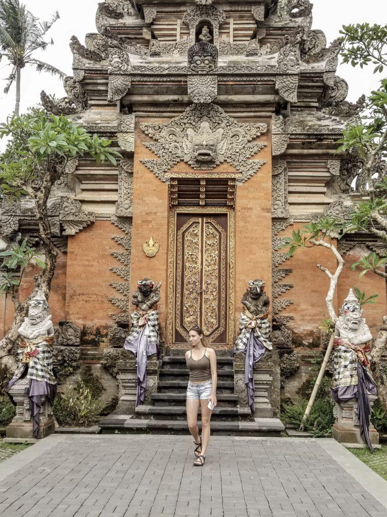 Sam infront of on of Ubud Palace doors