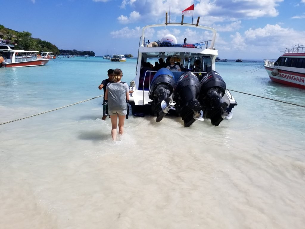 Wading to the Ferry in Indonesia with my LowePro Pack