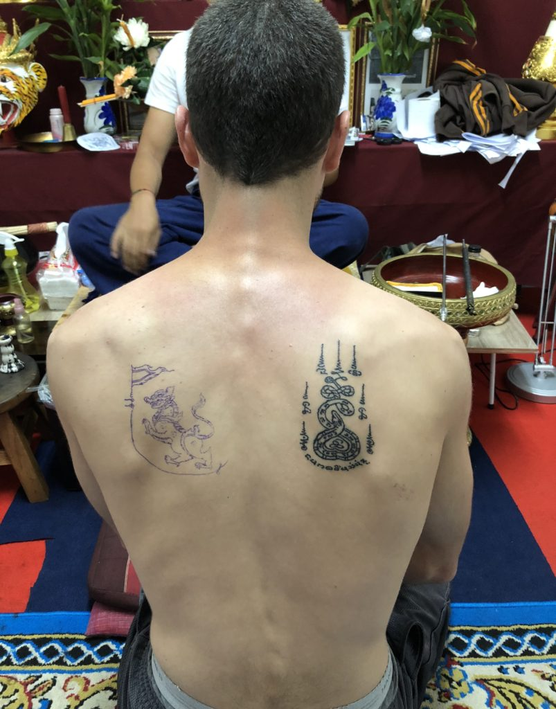 Tattoo outline on mans back in Chiang Mai, Thailand