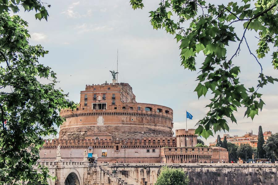 Castel Sant'Angelo in Rome, Italy through the trees. Add it to your 4 days in Rome itinerary