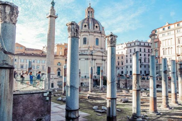 Trajan Forum Rome ruins with columns and cathedral. Stop by with 4 days in Rome