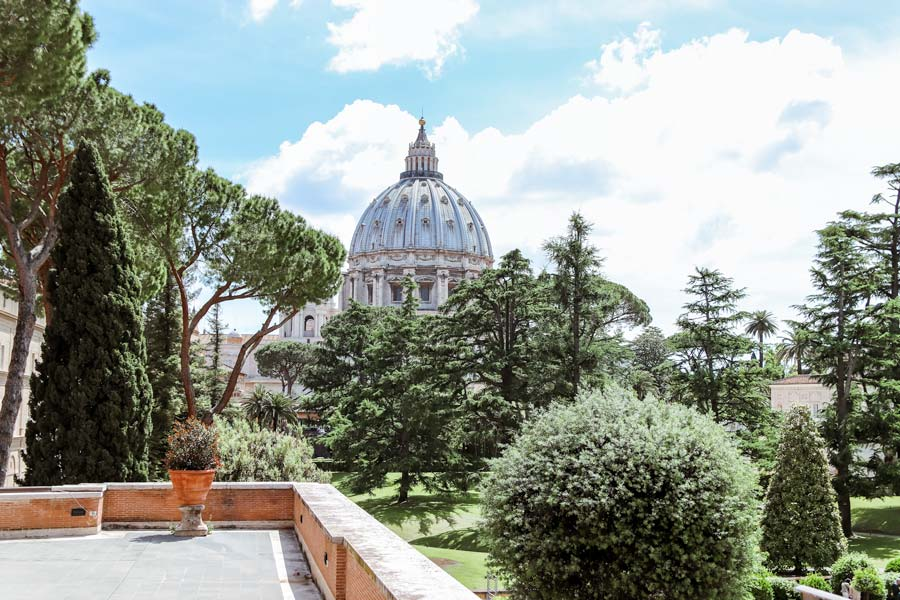 Outside the Roman Vatican in Italy with views of the garden and top of the Cathedral. Make sure to visit the Vatican with 4 days in Rome