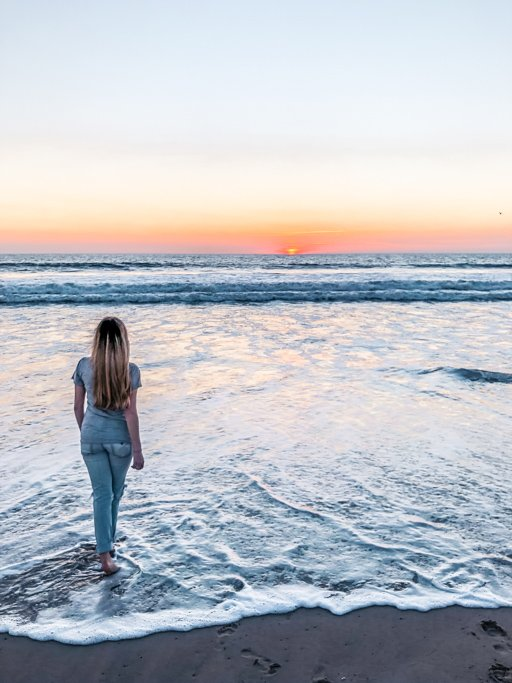 Watch the sunset from Venice Beach in Los Angeles, California