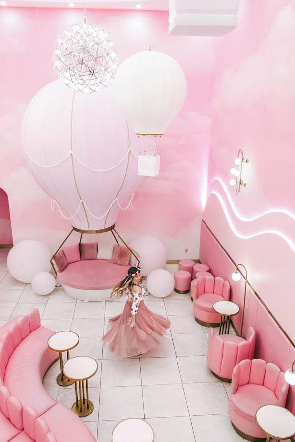 NYC M- Tea Bubble Cafe is very Instagrammable places with pink designs and hot air balloon prop.