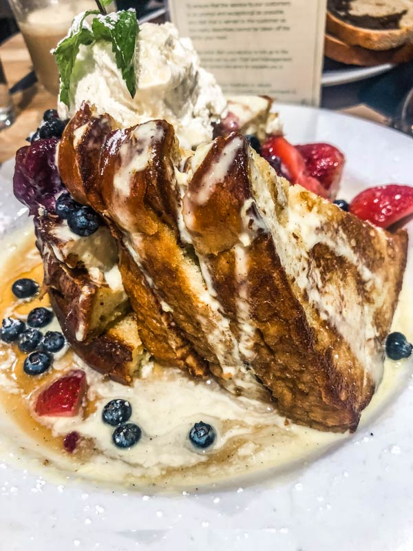 Make sure to get the Creme Brule French toast at Green Eggs Cafe during your weekend in Philadelphia