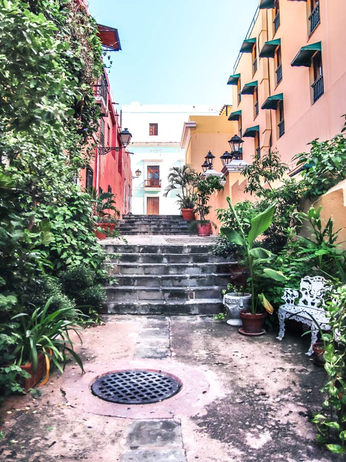 Old San Juan Puerto Rico alley with colorful buildings and plants