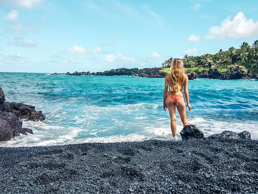 The black sand beach on the Road to Hana in Maui