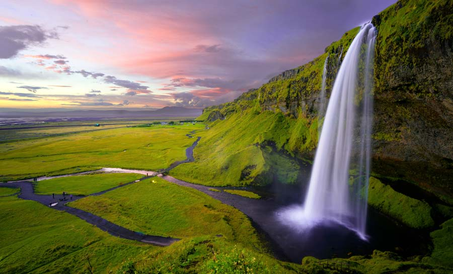 Seljalandsfoss Waterfall in Iceland. Iceland travel tips to wear waterproof clothing.