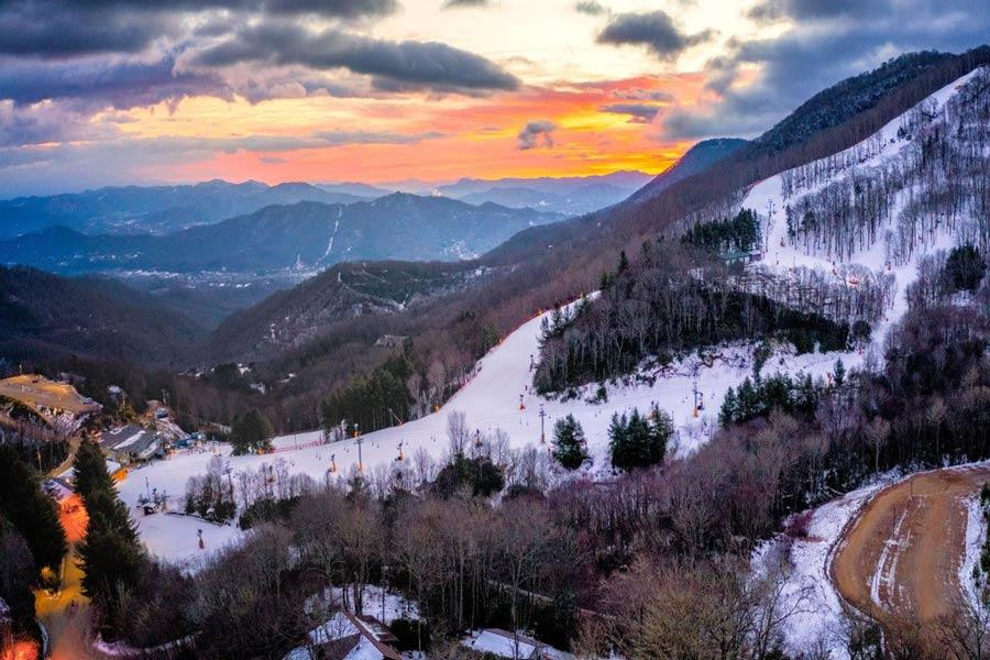 skiing in NC Cataloochee Ski Resort Mt. at sunset